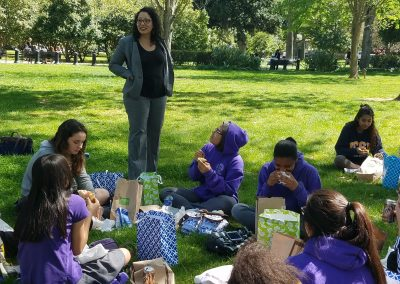 Assemblymember Cristina Garcia talking to the Girls Academic Leadership Academy during their lunch break