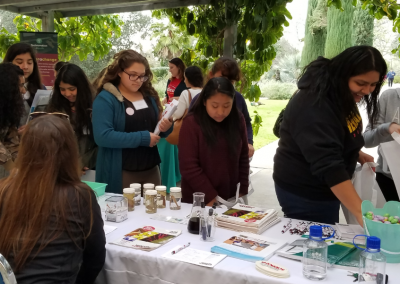 girls at a booth at the Los Angeles Country STEM Share Fair